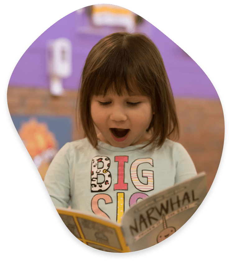 Happy Young Girl Reading Book